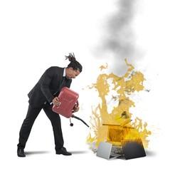 Businessman burns computers