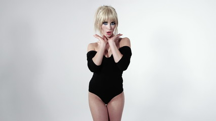 Beautiful girl wearing black body costume, studio.