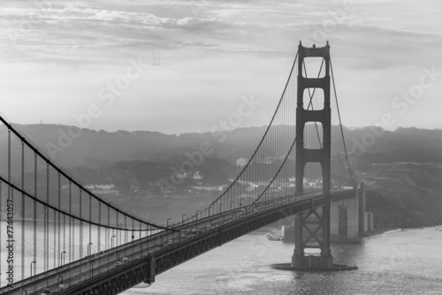 Fotobehang San Francisco Golden Gate Bridge with morning foggy black and white
