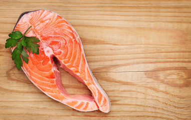 Piece of salmon on wooden background