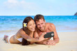 Beach holiday couple taking selfie with smartphone