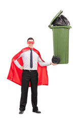 Superhero holding a large trash can