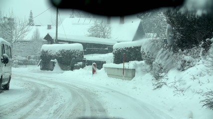 Travelling through the village on a snowy road