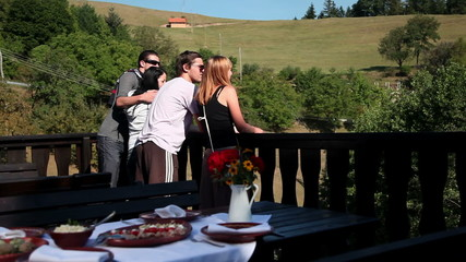 HD1080p: Two couples looking at nature before eating cold cuts