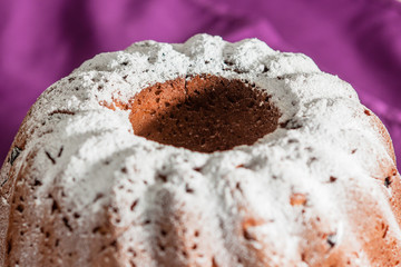 Easter cake with icing sugar and raisins