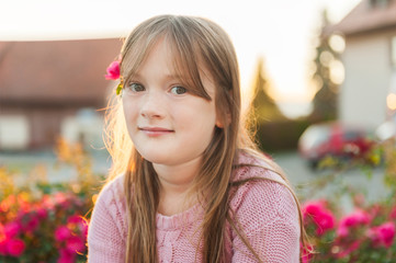 Close up portrait of a cute little girl resting outdoors