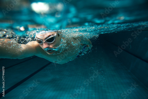 Poster Male swimmer at the swimming pool.Underwater photo.