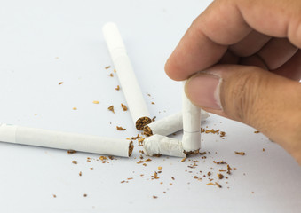 Close-up Of Human Hands Breaking The Cigarette