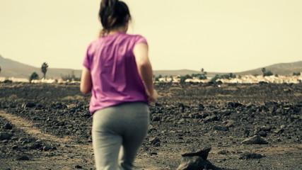 Woman jogging on desert, slow motion shot at 240fps