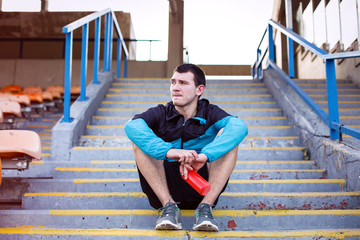 tired sportsman sitting on the stairs