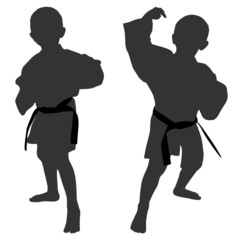 Silhouettes of two little boys who playing karate