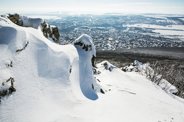 Snowy rocks with Nitra city in the background