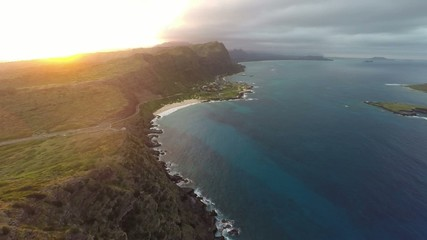 Aerial of Makapu'u Beach, cliffs, and lighthouse at sunset