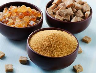 Brown sugar  in clay bowls .