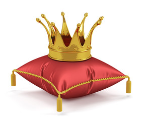 Golden king crown on the red pillow