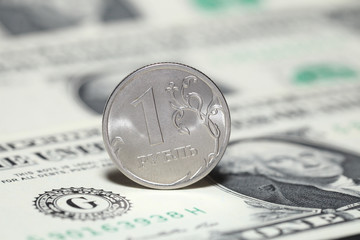 Ruble coin and dollar banknotes