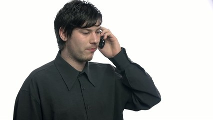 Male talking on phone with serious expression