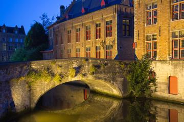 Ancient bridge at Dijver Canal in Bruges at night. (Belgium)