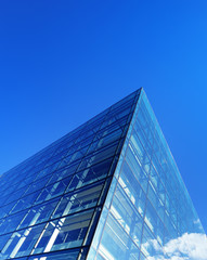 Generic glass building facade against sky