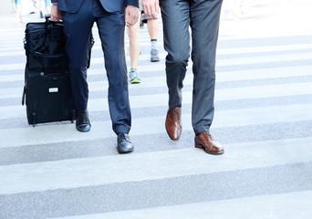 Businessmen crossing street