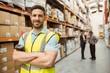 Leinwandbild Motiv Smiling worker standing with arms crossed