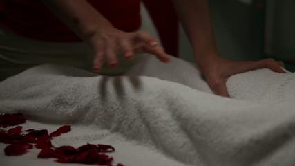 Massaging legs in the beauty salon