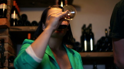 HD1080p: Young woman tasting in a wine cellar