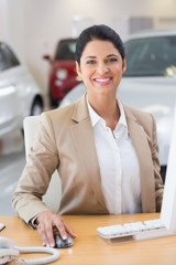 Smiling businesswoman working in her desk