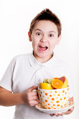 Boy with citrus fruits
