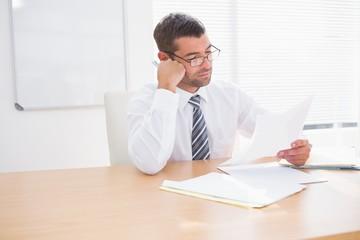 Focused businessman reading document