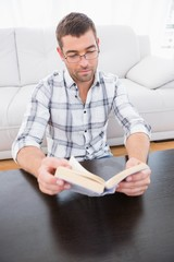 A serious man reading a man