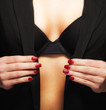 Glamour girl in unbuttoned jacket with red nails
