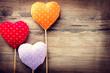 Valentines vintage handmade hearts over wooden background