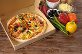 Freshly baked Pizza in delivery box with ingredients. - 77454691