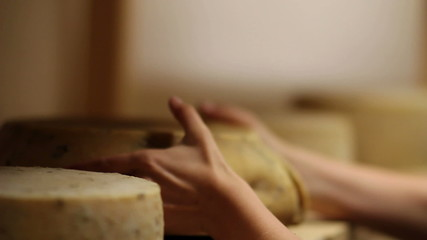HD1080p: Close up of woman's hand moving cheese with changing focus