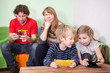 Children and husband are passionate about games in cellphones