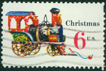 stamp printed in the USA shows Tin and Cast-iron Locomotive, Toy