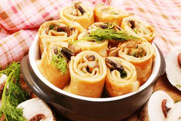 Pancakes with mushrooms. Mushroom appetizer.