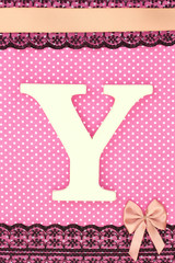 Wooden letter Y on polka dots background