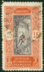 stamp printed by Dahomey, shows Man Climbing Oil Palm
