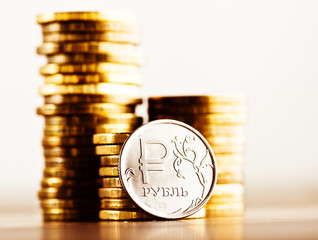 The Russian rouble coin and gold money on the desk