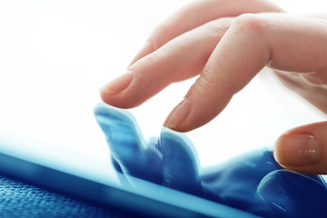 closeup of finger touching screen on tablet-pc