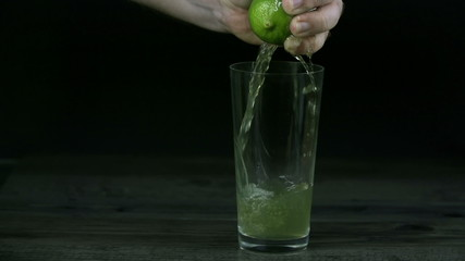 Flow of lime juice as consequence of squezzing