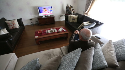 Watching Television and using Remeto Control