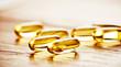 Leinwandbild Motiv Fish oil omega 3 gel capsules  on wooden background