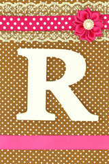 Wooden letter Ron polka dots background