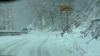 Driving on the side roads in the cold snowy winter