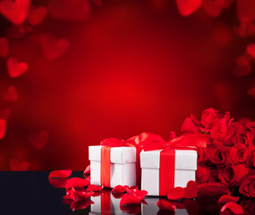 Gifts with roses on black glass table