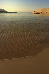 Sandy bay at sunset