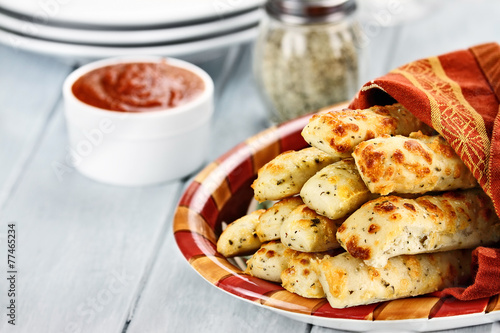 Foto op Plexiglas Brood Cheesy Asiago Breadsticks and Marinara Sauce